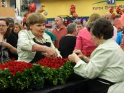 Kroger floral team member Cathy Sheppard, left, worked on the rose garland. She has helped make the Derby winner's garland the entire 27 years that Kroger has been providing it.