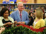 John Hackett, president of the Kroger Co.'s Mid-South Division visited with NBC-TV's weather anchor Dylan Dreyer, right, who was filming a segment about the Derby rose garland for Weekend Today at the Middletown Kroger. At left is Kroger floral team member Carol Belser.