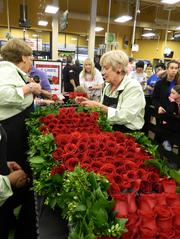 Work on the rose garland was well under way about 8 p.m. on Friday.