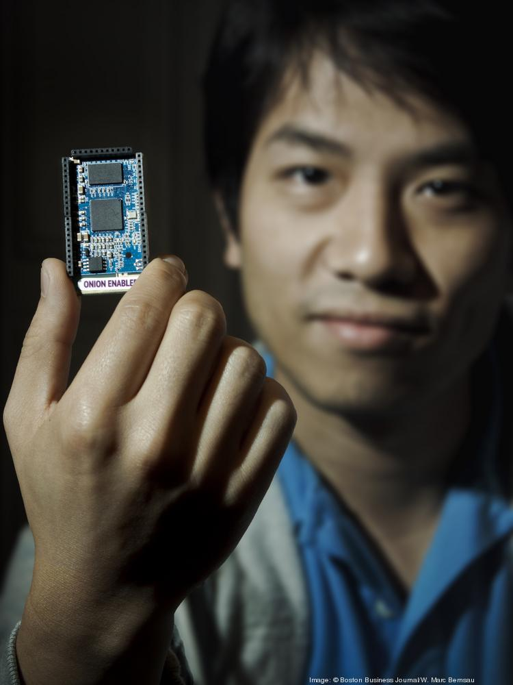 Boken Lin, co-founder of Boston software firm Onion, holds a module used to wirelessly connect devices.