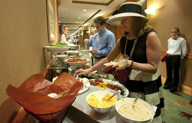 Carol Bennett, a guest of Midwestern Insurance Alliance LLC in the Finish Line Suites, went through the buffet line on Derby Day.