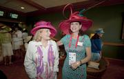 Vivian Ruth Sawyer, left, and Janine Broussard, right, spent Derby Day in Humana Inc.'s Finish Line Suite.