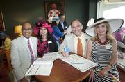 From left, Vipin Gopal, director of clinical analytics for Humana Inc.; Shina Kapiyath; Christopher Nicholson, vice president and chief operating officer of Humana's health and productivity segment; and Lynda Nicholson spent time in Humana's suite on Derby Day.