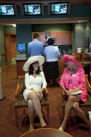 From left, Lorie Glisson and Jana Liston spent time chatting between races in Humana Inc.'s Finish Line Suite.