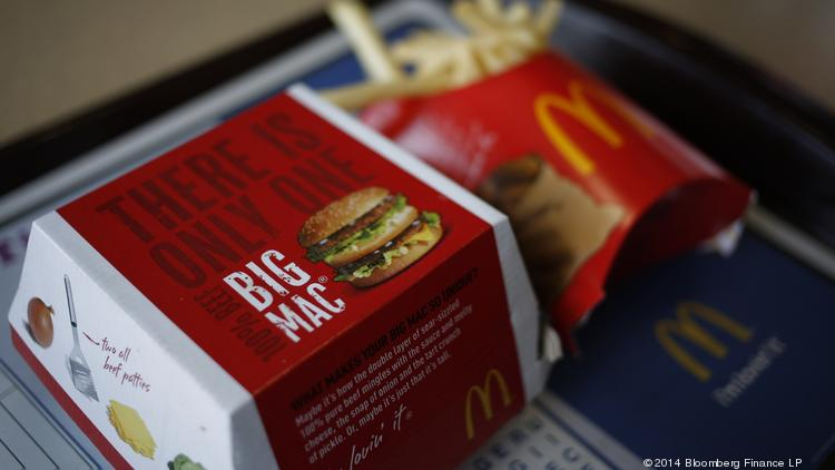 A McDonald's Corp. Big Mac and french fries are arranged for a photograph.