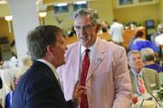 Bellarmine University president Joseph McGowan, at right, chatted with an unidentified Derby patron on Millionaire's Row. McGowan bet on Bellarmine, who won the fifth race at Churchill Downs.