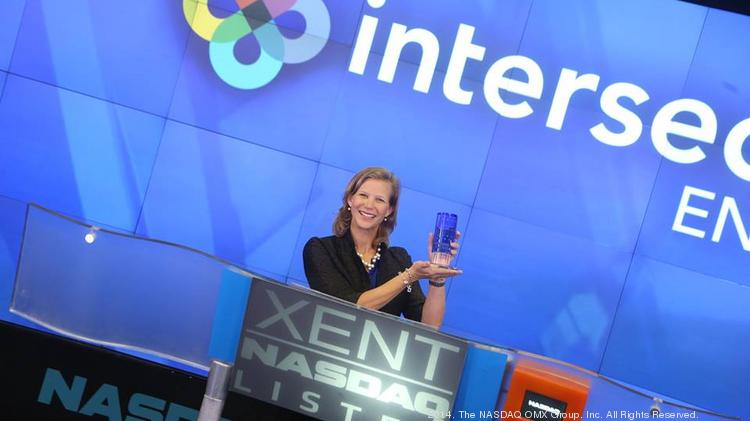 Lisa Earnhardt, CEO of Menlo Park nasal implant maker Intersect ENT, celebrates at Nasdaq after raising $55 million in an IPO.