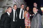 Louisville businessman Jonathan Blue, front right, and his wife, Tracy Blue, came to the party with Tyler Winklevoss, Cameron Winklevoss and friends.