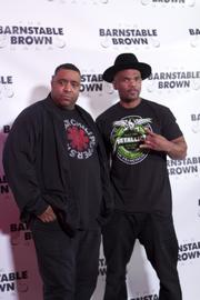 """Musician Darryl """"D.M.C."""" McDaniels, right, poses on the red carpet at the 2013 Barnstable Brown Gala."""