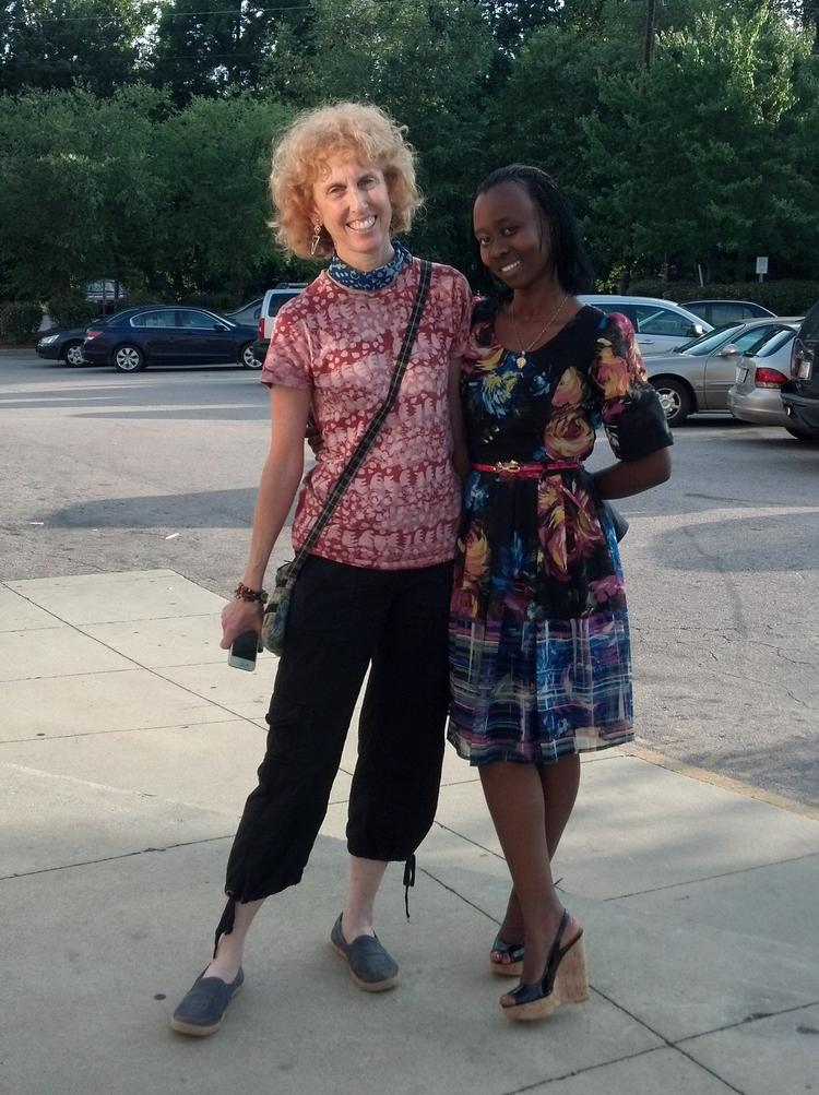 Sharon Gale of Unique Batik in Raleigh (left) with Monica Umwari, owner of Angaza, a Rwandan handbag company that uses recycled materials.