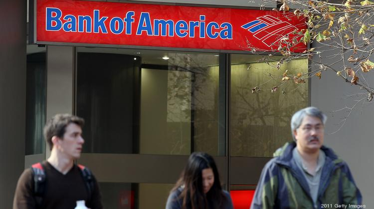 Pedestrians walk by a Bank of America branch office in San Francisco.