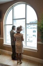 Phil Dodd and Lynn Courtney, both of Evansville, Ind., looked onto the paddock from the Jockey Club Suites.