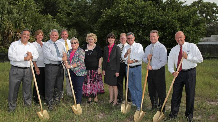 Taking part in the Patriot Bank Palm Harbor groundbreaking are (from left) Andrew Salzman, Patriot Bank director, partner in Unice Salzman PA; Kelly Lopez, teller, Palm Harbor; David Key, president and CEO; Kurt Beste, senior vice president and senior lender; Arlene Tracht, customer service manager, Palm Harbor; Katharine Tapp, customer service representative, Palm Harbor; Carol Miller, senior vice president and chief compliance officer; Thomas Wokurka, executive vice president and chief financial officer; Michael Cronin, director, partner at Johnson Pope Bokor Ruppel & Burns LLP; Allen Crumbley, director, president at Berkshire Hathaway Home Services Florida Property Group; and Gregory Roe, director and president of Roe Insurance Inc.