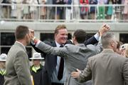 Orb supporters celebrated the horse's Derby victory in the winner's circle.
