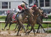 Derby Winner Orb moves toward the lead in the homestretch.