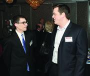 Robert Zaremberg, left, of Junior Achievement of Western Pennsylvania and Ben Bestic of Barracuda Networks.