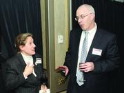 Barbara Fisher of OE-A and Brian Sheridan of Huntington Bank.