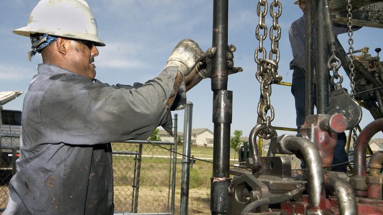 An oil worker in Colorado works at a production field about 27 miles north of Denver, in the Denver-Julesburg Basin.