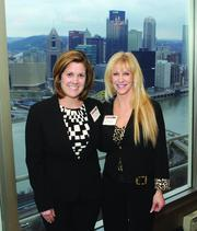 Brooke Saunders, left,  of Carol Harris Staffing, LLC and Kim Conley of ISM Services, Inc.