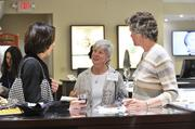 From left: Dr. Lorri Ayers, Dr. Carolyn Hart and Sandy Godwin converse at the Best Doctors reception.