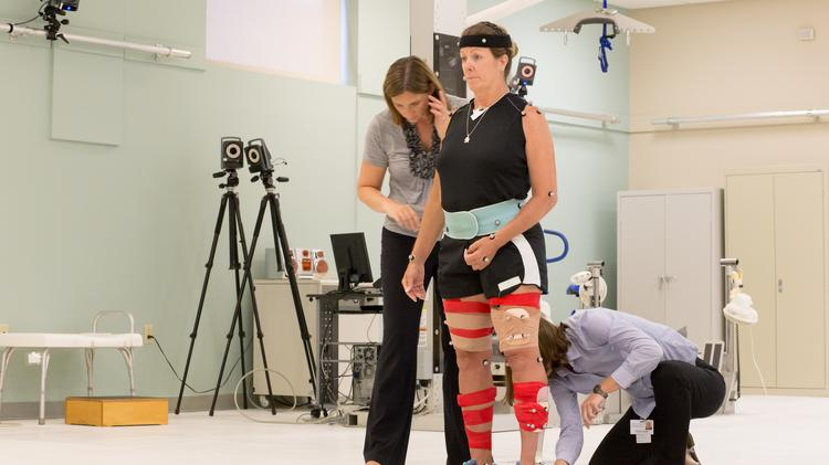 A patient gets hooked up to Brooks Rehabilitation's new high tech imaging system.