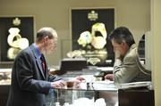 Dr. Andrew Antoszyk (left) browses merchandise at Windsor Jewelers during the Best Doctors reception.
