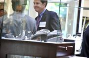 Dr. Jeffrey Glen Walls is seen here through a glass merchandise case at Windsor Jewelers.