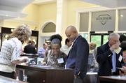Josh Wallace (center), and Dr. Shana Wallace look over merchandise at Windsor Jewelers, where the Best Doctors reception was held.