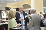 Dr. Richard Sigmon (center) speaks to fellow attendees at the Best Doctors reception at Windsor Jewelers.