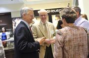 Facing the camera are Drs. Thomas Rapisardo and Edwin Shoaf as they network with fellow Best Doctors event attendees.