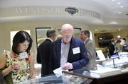 Karen Scully and Dr. Patrick McElgunn browse the merchandise cases at Windsor Jewelers during the Best Doctors reception.