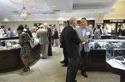 Best Doctors honorees, guests, sponsors and Windsor Jewelers personnel mingle at the reception.
