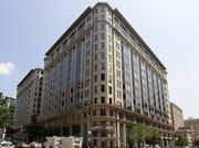 The assessed value of the Thurman Arnold Building at 555 12th St. NW will fall to $508.9 million in 2015, a reflection of the lower sale price paid for the property given anchor tenant Arnold & Porter LLP is planning to move out.