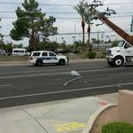 Intense dust and lightning storm topples light poles, uproots trees in north Phoenix