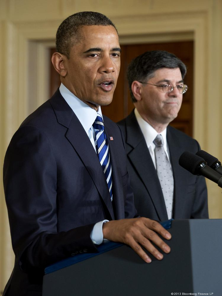 President Barack Obama, left, speaks while U.S. treasury secretary then-nominee Jack Lew listens during a press conference at the White House in this file photo.