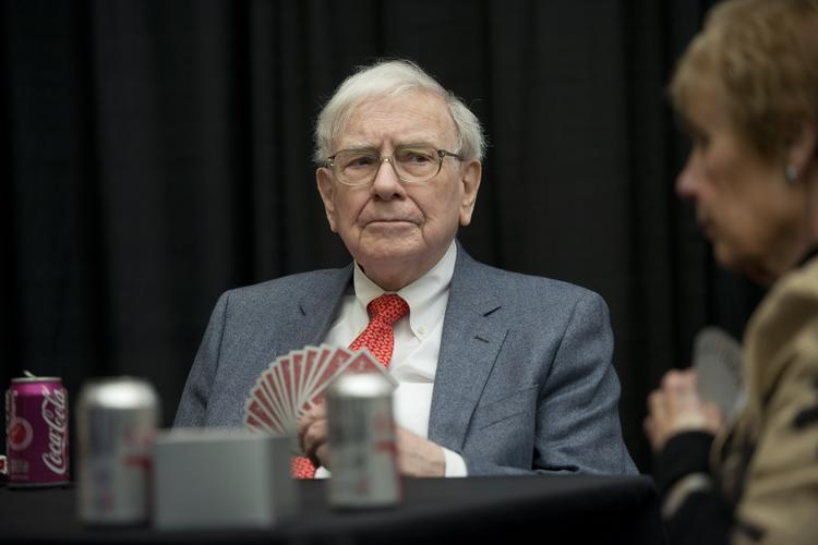 Warren Buffett, CEO of Berkshire Hathaway, plays bridge with shareholders during an event in Omaha, Neb., on Sunday.