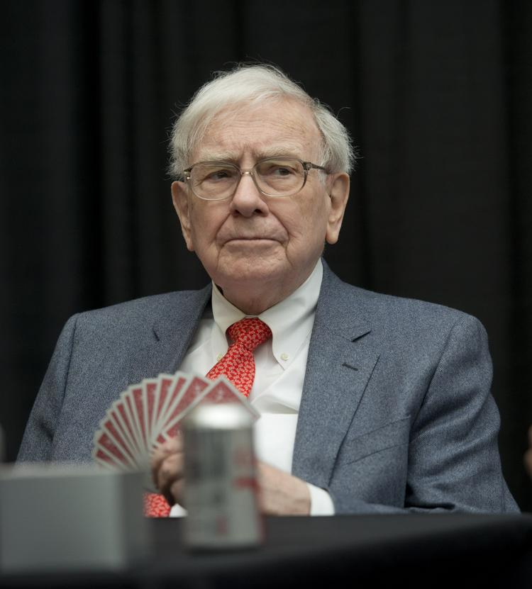 Warren Buffett, chairman and CEO of Berkshire Hathaway, Inc., plays bridge with shareholders during an event in Omaha, Neb., on May 5, 2013.