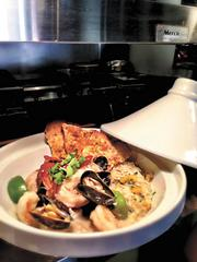 Ocean - Thai green curry bouillabaisse with lobster tail, shrimp, grouper, mussels and pineapple ginger jasmine rice  $42