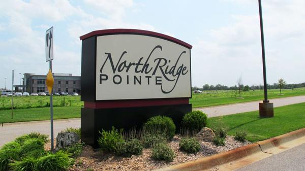 Three properties in the North Ridge Pointe development near 37th Street North and Ridge Road will be auctioned next month in an effort to increase commercial activity there.