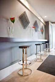 Stools and art decorate a wall in the new Butler Snow space.