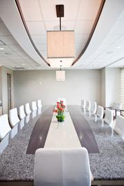 The Volunteer Room features white leather chairs.
