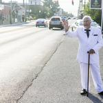 'Col. Sanders' offered gas station customers a fill-up Tuesday morning