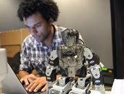 Computer science grad student Corey Pittman works on a remote control program that will copy and mimic the physical movements of the operator.