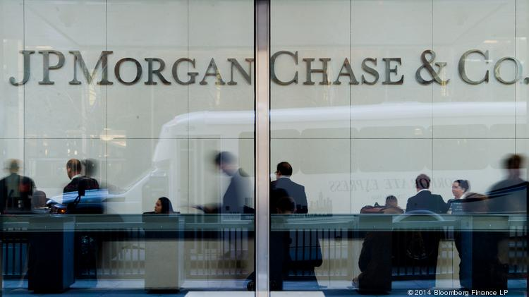 People stand inside the lobby of the JPMorgan Chase headquarters building in New York.