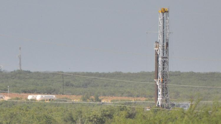 Drilling rigs in operation near the Eagle Ford Shale town of Cotulla. Production in the South Texas oil formation was up substantially in June.