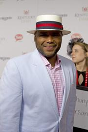 Actor Anthony Anderson stopped for a photo on the red carpet at Churchill Downs.