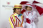 Larry Birkhead and daughter Danielynn pose for the camera in Mary Poppins costumes on the red carpet.
