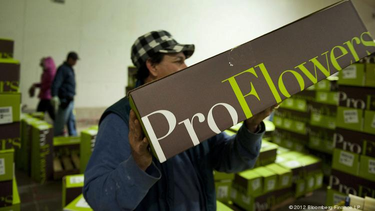 A ProFlowers employee stacks boxes of bouquets before shipping at a distribution facility in Charlotte, North Carolina.