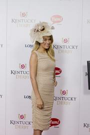 Television personality and fashion designer Lauren Conrad posed for photographers on the red carpet at Churchill Downs.