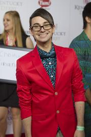 Fashion designer and Project Runway season 4 winner Christian Siriano posed for a photo on the red carpet.